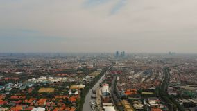 Surabaya capital city east java, indonesia. Aerial cityscape densely built asian city, seaport. urban environment in asia. modern city Surabaya with buildings royalty free stock image