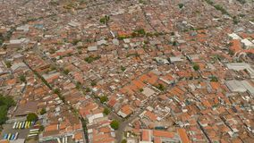 Surabaya capital city east java, indonesia. Aerial cityscape densely built asian city. urban environment in asia. modern city Surabaya with buildings and houses stock image