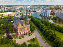 Aerial cityscape of Kant Island in Kaliningrad, Russia. Aerial cityscape of historical city centre at sunny summer day with white clouds in the blue sky Royalty Free Stock Image