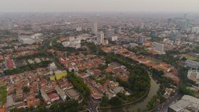 Surabaya capital city east java, indonesia. Aerial cityscape modern city Surabaya with skyscrapers, buildings and houses. sunset in city skyline with skyscrapers stock photography