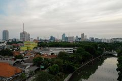 Surabaya capital city east java, indonesia. Aerial cityscape modern city Surabaya with skyscrapers, buildings and houses. sunset in city skyline with skyscrapers stock photo