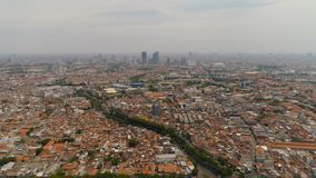 Surabaya capital city east java, indonesia. Aerial cityscape modern city Surabaya with skyscrapers, buildings and houses. urban environment in asia city skyline royalty free stock images