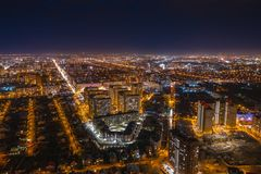 Aerial cityscape panoramic view, flight on drone above night city Voronezh with illuminated roads and high-rise buildings. Toned stock photos