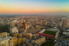 Aerial cityscape of Povoa de Varzim, Portugal at dusk with blue-orange gradient sky. Aerial / drone shot, cityscape of the city of Povoa de Varzim, Porto stock photo