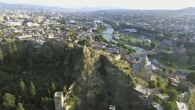 AERIAL. The cityscape of Tbilisi the Narikala fortress. GEORGIA stock video footage