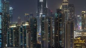 Aerial cityscape timelapse at night with illuminated modern architecture in Downtown of Dubai, United Arab Emirates. Illuminated Financial district view from stock video footage