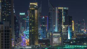 Aerial cityscape timelapse at night with illuminated modern architecture in Downtown of Dubai, United Arab Emirates. Illuminated Financial district view from stock footage
