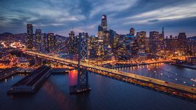 Free Aerial Cityscape View Of San Francisco And The Bay Bridge At Night Stock Images - 122375654