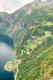 Aerial close-up view of a zig-zag winding road going up a steep slope near Geiranger, Norway royalty free stock image