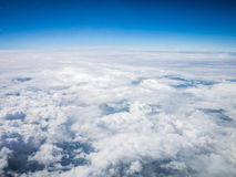 Aerial cloudscape in stratosphere. Aerial cloudscape sky in stratosphere shot from airplane window Stock Photos