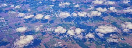 Aerial Cloudscape view over midwest states on flight over Colorado, Kansas, Missouri, Illinois, Indiana, Ohio and West Virginia du. Ring autumn. Grand sweeping royalty free stock photos