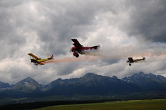 Aerial combat -Aerial acrobatics. Three antique  aircraft on display at an airshow.-light-armed Royalty Free Stock Image