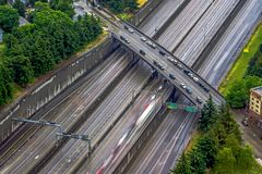 Aerial of commute traffic and bridge crossing. Aerial of commute traffic and bridge  crossing Royalty Free Stock Images
