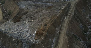 Aerial copter shot of the city dump. Flocks of birds fly over the big piles of garbage trash outside the city. Dirty earth, ecological damage stock video footage