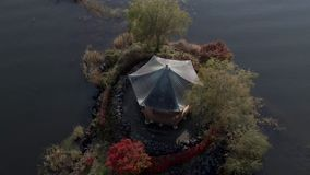 Aerial Crane shot of Hexagonal japanese temple built in 1200`s in Fuji lakes area Japan. Autumn, fall red maple leaves and glisten stock video footage