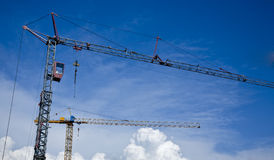Aerial cranes and blue sky Stock Photos