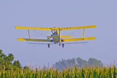 Aerial Crop Duster. Image of aerial crop duster spraying corn field in rural Iowa stock images