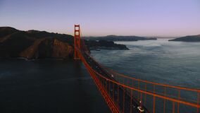 Aerial Crossing the Golden Gate Bridge toward the Marin Headlands Bay, San Francisco evening