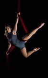 Aerial dancer woman on black stock photo