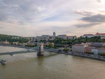 Aerial of Danube river panorama with a view on Buda castle and Chain Bridge in central Budapest.  royalty free stock image