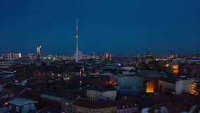 AERIAL: Day to Night Drone Hyper Lapse, Motion Time Lapse over Berlin with Alexanderplatz TV Tower view and beautiful