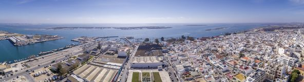Aerial daytime view of Olhao downtown and Marina seascape. Algarve. Portugal. Aerial daytime view of Olhao downtown and Marina seascape, waterfront to Ria Stock Images