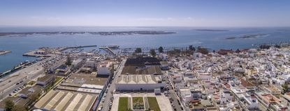 Aerial daytime view of Olhao downtown and Marina seascape, water. Front to Ria Formosa natural park. Algarve. Portugal Stock Image