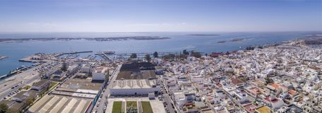 Aerial daytime view of Olhao downtown and Marina seascape. Algarve. Portugal. Aerial daytime view of Olhao downtown and Marina seascape, waterfront to Ria Stock Image