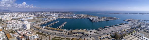 Aerial daytime view of Olhao fishing dock and seascape. Algarve. Portugal. Aerial daytime view of Olhao fishing dock and seascape, waterfront to Ria Formosa Stock Photo