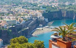 Aerial daytime view of Sorrento, Amalfi coast, Italy. Streets of city with hotels and restaurants are located on rocky seashore, tourists have a rest on stock photo