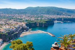 Aerial daytime view of Sorrento, Amalfi coast, Italy. Streets of city with hotels and restaurants are located on rocky seashore, tourists have a rest on royalty free stock photography
