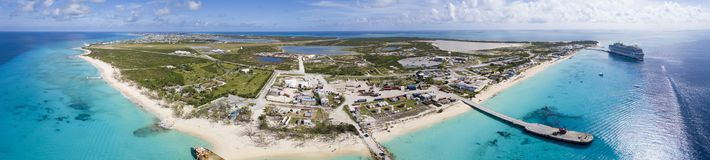 Aerial 180 degree panorama of the entire island of Grand Turk. With cruise ship in the harbor Royalty Free Stock Photos