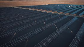 Aerial desert view large industrial Solar Energy Farm producing concentrated solar power. Around the mountain and the stock video footage