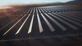 Aerial desert view large industrial Solar Energy Farm producing concentrated solar power. Around the mountain and the stock footage