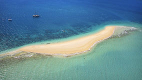 Aerial of a destination island in the Whitsundays. Aerial of a long sandy beach on Langford Island in the Whitsundays, Queensland Australia. Beautiful turquoise Stock Photos