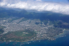 Aerial of Diamond Head Crater, Kaimuki, Kahala, and Honolulu wit. H clouds hanging over the mountains on nice day. November 2014 royalty free stock images