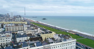 Aerial dolly view of the town of Brighton and Hove towards the beach
