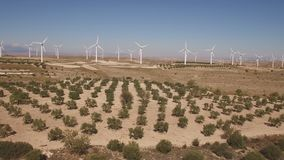 Dolly zoom over windmill farm and trees stock video