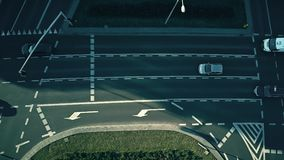 Aerial down view of major city street traffic. Aerial down view of city street traffic stock video footage