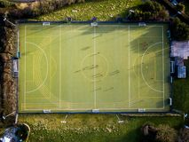 A downward view of a football pitch in Kingsbridge, UK. An aerial downward view of people playing football on a pitch in Kinsbridge, Devon, UK royalty free stock photo