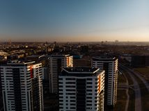 Aerial dramatic scenery sunset with a view over skyscrapers in Riga, Latvia - Old Town downtown is visible in the stock image