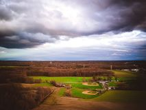 Aerial of Dramatic Sky Over Baseball Fields stock photo