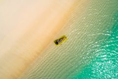 Aerial drone aerial view of Beautiful girl having fun on the sunny tropical beach. Seychelles.  royalty free stock images