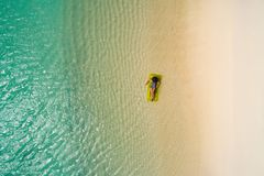 Aerial drone aerial view of Beautiful girl having fun on the sunny tropical beach. Seychelles.  stock image