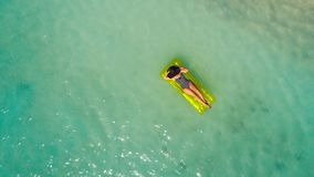 Aerial drone aerial view of Beautiful girl having fun on the sunny tropical beach. Seychelles.  stock photos