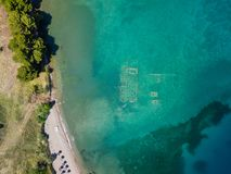 Aerial drone bird`s eye view photo of tourists snorkeling above old Sunken City of Epidauros, Greece royalty free stock photos