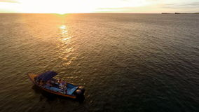 Aerial drone of a boat during sunset stock footage