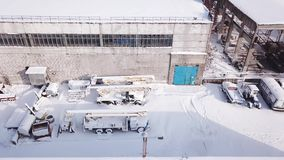 Aerial drone flight  of the old metal warehouse. Aerial drone flight of the old metal warehouse. Construction equipment is located on the territory of the stock video