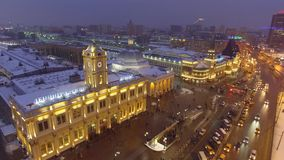 Kutuzovskiy prospect avenue Triumphal Arch holiday decoration. Night lights illumination. Moscow Russia cowered in snow and ice. Aerial drone flight. High stock video footage