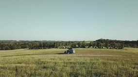 Aerial drone flight over the car in the field,summer sunny days. Aerial drone flight over the car in the field,summer sunny days,4k stock footage